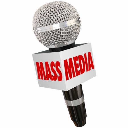 podcasting: Mass Media words on a microphone box to illustrate interviews and reporting on tv, radio, internet, podcasting and other multimedia formats Stock Photo
