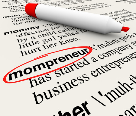Mompreneur word circled in a dictionary with words explaining definition of mother working at home as entrepreneur on a new business startup