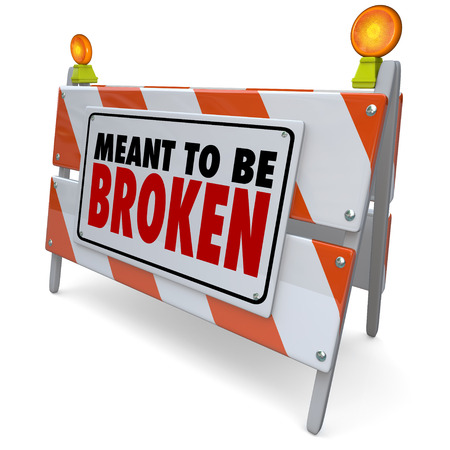 meant: Meant to Be Broken words on a barricade or road construction sign to illustrate laws or rules you protest, break or rebel against Stock Photo