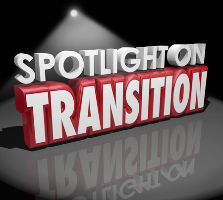 Spotlight on Transition words in 3d letters to illustrate change or different transformation