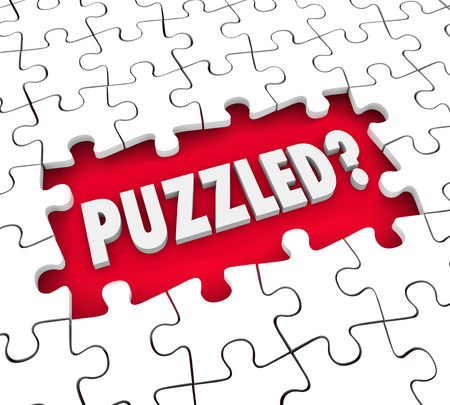 perplexing: Puzzled word in 3d letters in a hole for missing pieces to illustrate a feeling of being lost, confused, stumped or baffled Stock Photo
