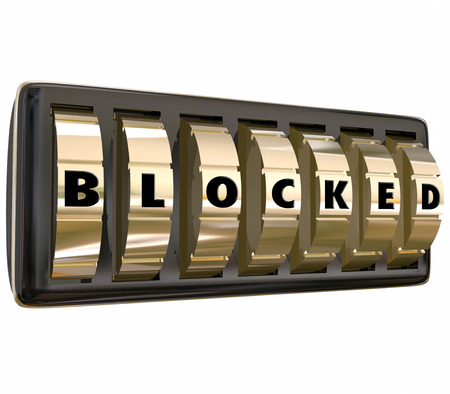 hindering: Blocked word on gold safe dials to illustrate an area that is off limits, blocked, secured, protected and preventing theft and crime