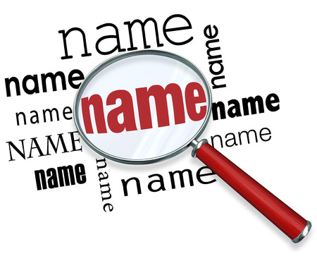 surname: Name word under magnifying glass to illustrate searching or looking for and finding people Stock Photo