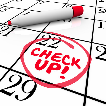 prescribe: Check Up words on a calender written by red pen or marker to remind you of an exam, test or medical doctor appointment on your schedule