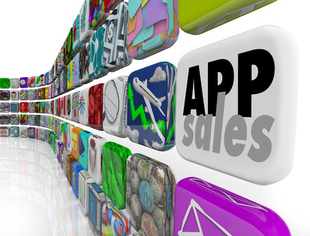 App Sales words on a tile to illustrate downloads of programs, applications or software to mobile devices