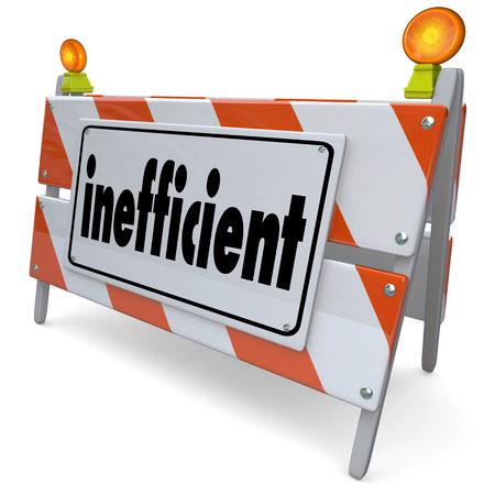 ineffective: Inefficient word on a road construction sign or barrier to illustrate a process, procedure, system or performance that is poor, ineffective or unproductive Stock Photo