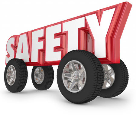 road: Safety driving word with wheels or tires to illustrate safe traveling in car, automobile, truck or other vehicle on the road