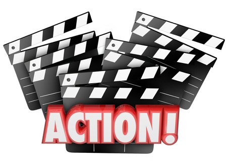 action movie: Action word on movie clapper boards to illustrate directing, acting, producing or making a film or theatrical event for entertainment and enjoyment before an audience
