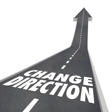 Change Direction, course, route, or new vision for moving forward or progress with words on a street or road pavement