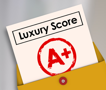 indulging: Luxury score A Plus grade on report card to illustrate rating or level of being rich or wealthy with upscale living conditions