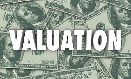 estimating: Valuation word on hundred dollar bills background to illustrate evaluation or assessment of company or business net worth with assets, revenue and multiples