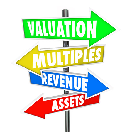 Valuation, multiples, revneues and assets words on arrow signs to illustrate calculation or formula for evaluating a company or business worth Stock Photo
