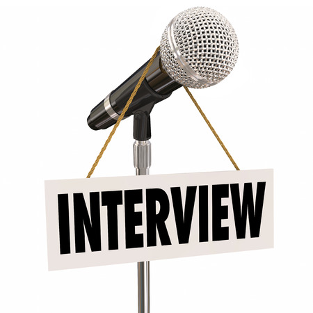 interviewed: Interview word on hanging sign on microphone to illustrate questions and answers for a speaker or panel discussion