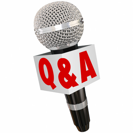 answered: Q and A letters on a microphone box for questions and answers in an interview or broadcast reporter discussion Stock Photo