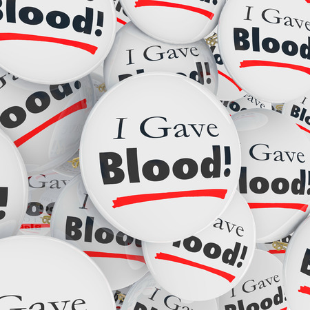 gave: I Gave Blood buttons or pins as thank you message or appreciation to a donor at a drive or charity event Stock Photo