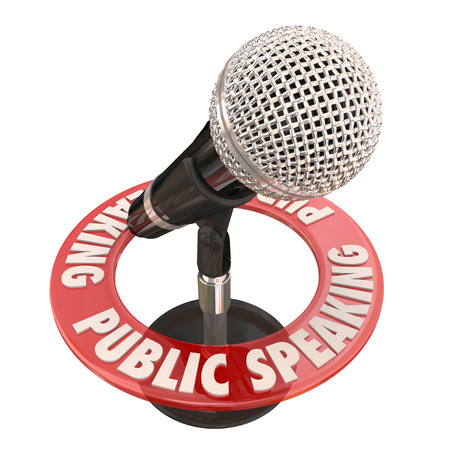 panelist: Public Speaking words in red ring around a microphone to illustrate a keynote speaker giving a speech or address to an audience or crowd at a meeting or gathering Stock Photo