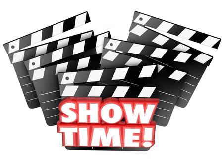 show time: Show Time words on movie clappers for a theatre to begin playing a feature film presentation for entertainment or enjoyment of an audience