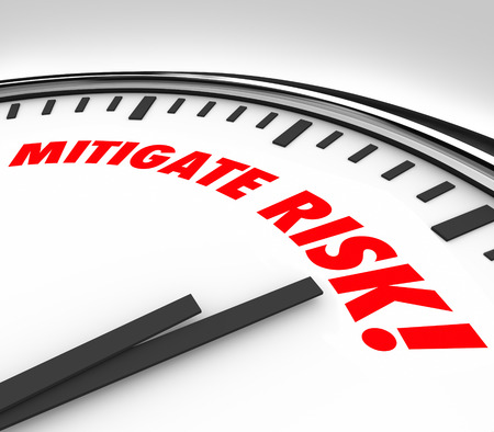 mitigate: Mitigate Risk words on clock to illustrate reducing dangers, hazards, liabilities or cause for injury or damages at a company, worksite or public place Stock Photo