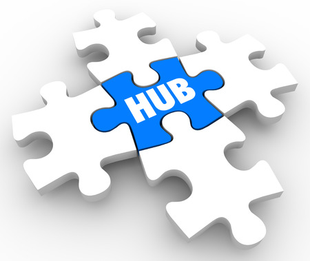 middle joint: Hub word on puzzle piece in center or middle of connection or network to illustrate the integral pivot point in an organized system or process Stock Photo