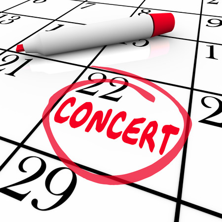 reminding: Concert word on a calendar or schedule reminding you of a performance event for a singer, musical group or recital Stock Photo