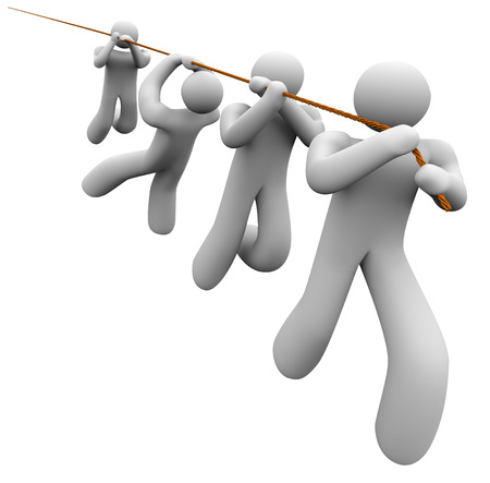Team of people working together pulling a rope to haul or lift an object, message or item in an important job or task through cooperation