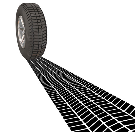 skid: Wheel Tire Skid Mark Tracks on a road as you are leaving a town or place, driving a car, automobile or other vehicle Stock Photo