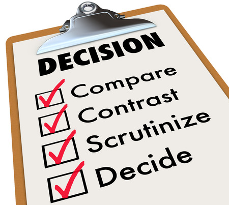 Decision checklist on a clipboard with check marks and boxes to illustrate comparing and contrasting several options
