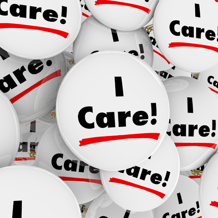 helping others: I Care words on buttons for caring, compassionate or helpful people, customer support or service workers or volunteers Stock Photo