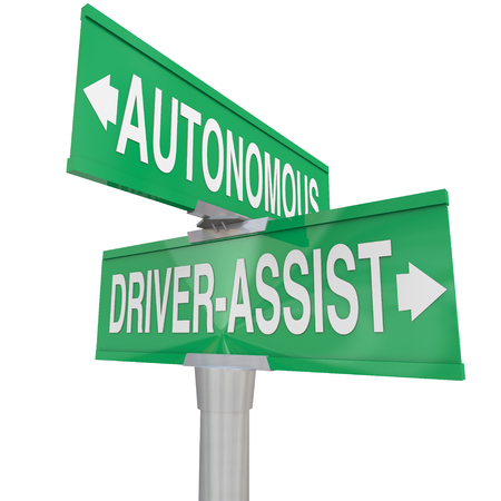 autonomy: Autonomous Driving and Driver Assist words on two way road signs to illustrate the differences between the vehicle technologies Stock Photo