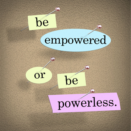 powerless: Be Empowered or Be Powerless words or saying in pieces of paper on a bulletin board to inspire, motivate or encourage you to achieve and succeed