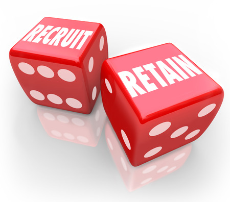 rewarding: Recruit and Retain words on two red dice to illustrate attracting job candidates, hiring employees and rewarding and keeping workers
