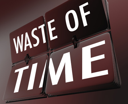 wasting away: Waste of Time words on flipping clock tiles to illustrate inefficient working habits and lost efforts due to ineffective procedures or just screwing around