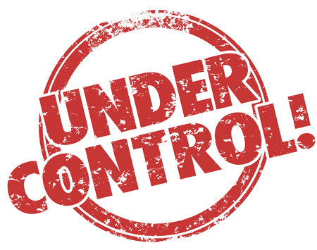 Under Control words stamped in red grunge style ink to illustrate work, job, task or project well managed and making progress Stock Photo