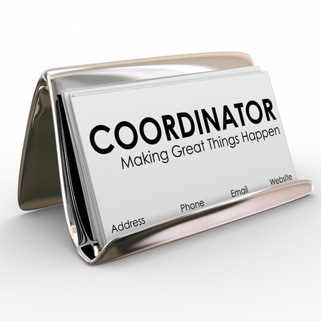 coordinating: Coordinator word on business cards in a holder to illustrate a job or position for a task or work supervisor, director or manager