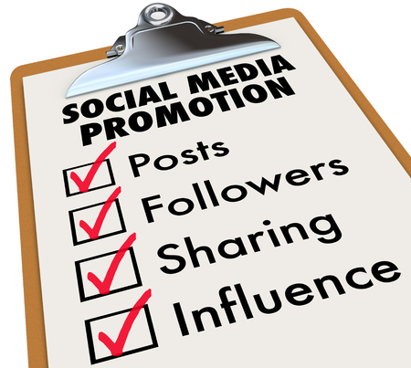followers: Social Media Promotion checklist on a clipboard with check marks and boxes for Posts, Followers, Sharing and Influence Stock Photo