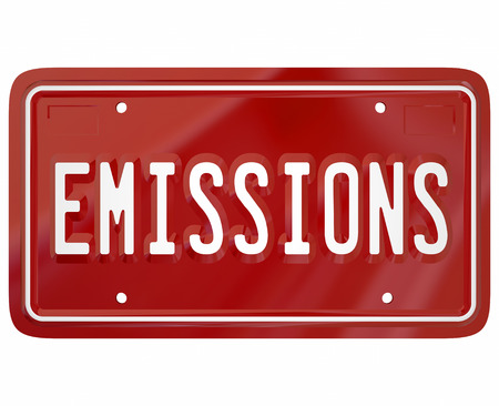 Emissions word on a red car or vehicle license plate to illustrate meeting or passing government rules, laws and regulations on automotive pollutants from gas or diesel fuel