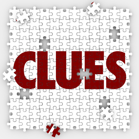 uncovering: Clues word on puzzle pieces to illustrate finding or searching for answers or a solution to a mystery Stock Photo