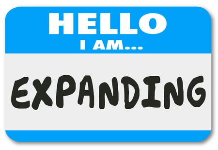widening: Hello I am Expanding words on a blue nametag or sticker to illustrate growth or increased success in business, career, job or life Stock Photo