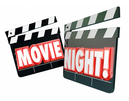 attend: Movie Night words in red 3d letters on movie clappers to illustrate spending an evening together watching films for entertainment and relaxation at home