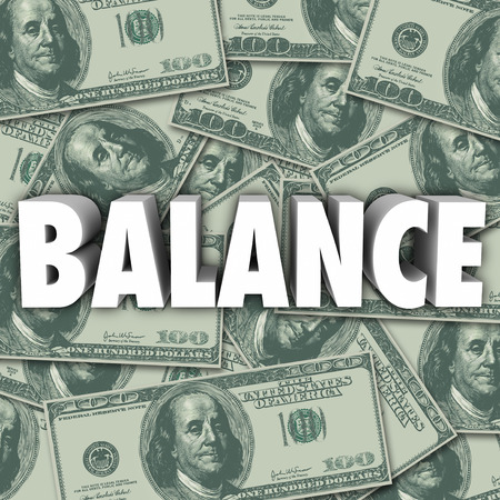budgeting: Balance word in 3d letters on a background of money in hundred dollar bills to illustrate budgeting, accounting and bookkeeping Stock Photo