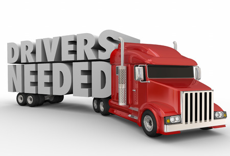 Drivers Needed words on a semi truck trailer to illustrate a job shortage in trucking, transporation and logistics carrier companies Stock Photo