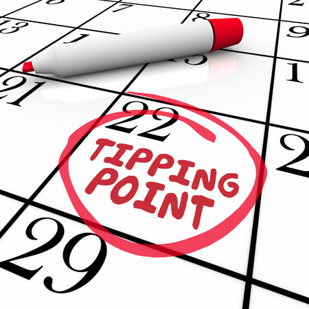time critical: Tipping Point words circled on a calendar day or date to illustrate critical mass, change, evolution and innovation