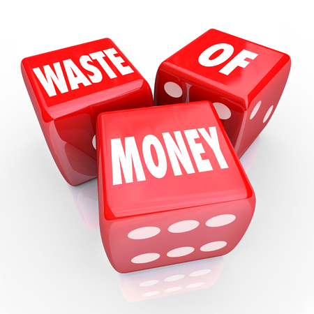 throw away: Waste of Money words on 3 red dice to illustrate wasteful spending or unwise purchase Stock Photo