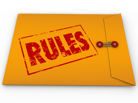 Rules word stamped in red ink on yellow envelope containing guidelines, laws, regulations or instructions Stock fotó