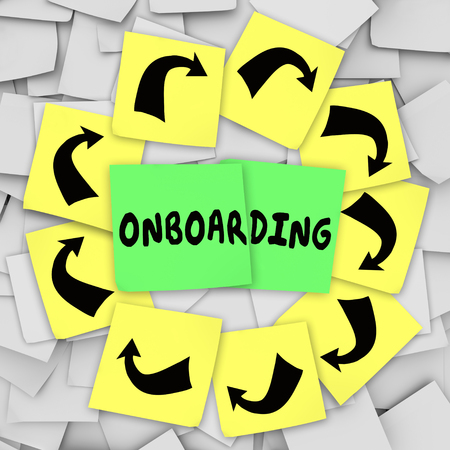 Onboarding word written on sticky note on bulletin board to illustrate introducing or welcoming new employee or hire to organization 写真素材