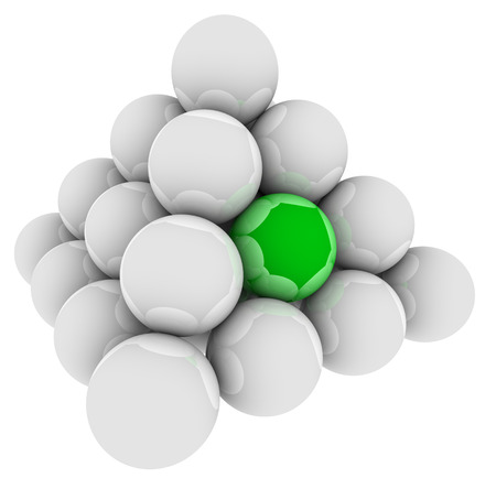 Green ball in a pyramid of spheres to illustrate standing out or being special, unique or different or best in the group
