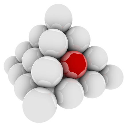 unique selling proposition: Red ball in a pyramid of spheres to illustrate standing out or being special, unique or different or best in the group Stock Photo