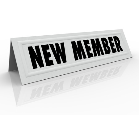 associates: New Member words on a tent card for the latest person to join a committee, club or group and welcoming to a meeting Stock Photo