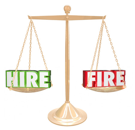 firing: Hire Vs Fire words on gold scale or balance to illustrate increasing or decreasing size of employee workforce Stock Photo