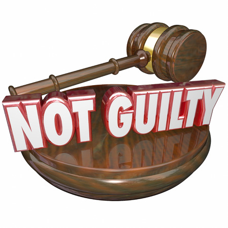 answered: Not Guilty words in 3d letters on a wood judge gavel or block as a verdict in a court case acquiting the defendent in a case or trial